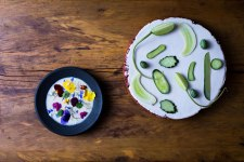Black porcelain, earthenware, porcelain slip, glaze,cucumbers, yogurt and edible flowers.food by Dan Barber.photograph by Andrew Scrivani