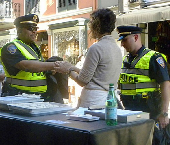 """Holly Hanessian, """"Touch in Real Time Project, Handshake with Policemen in NOLA"""""""