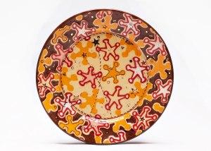 Sheriff Stars Dessert Plate, 2014. Ceramic, slip, underglaze, glaze and luster. Multi-colored screen printed underglaze transfers, shellac resist and multi-fired in an electric kiln. 1.25 x 7.25