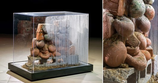 2014, Sculpture (clay, mold, cinderblocks, turf, steel, and Plexiglas vitrine; part of a larger installation with soundscape)