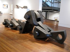 """Anatomy of the Machine, """"Articulation"""", H 18"""" x W 130"""" x D 36"""", 2008, Reduction Fired Stoneware and Steel"""