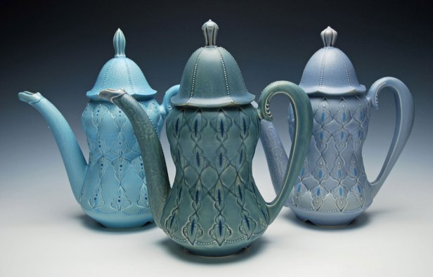 """Wheel-thrown, stamped, and altered porcelain w. hand-pulled spouts and handles, slip-sponge, slip-trail, and underglaze deco, cone 7 oxidation. Each approx. 11""""h x 11"""" l x 6"""" d, 2014"""