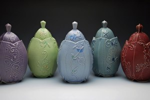 "Wheel-thrown and altered porcelain w. slip-sponge, underglaze, and slip-trail deco, cone 7 oxidation. Each approx. 9"" h x 5.5"" w x 5.5"" d, 2014"