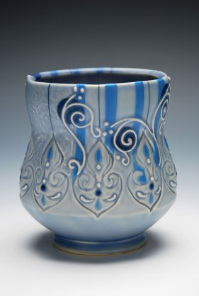 "Wheel-thrown, stamped, and altered porcelain w. slip-sponge, underglaze, slip-trail, and Mishima deco, cone 7 oxidation. 4.5"" h x 3.5"" diameter, 2013"