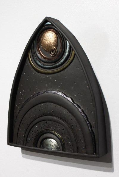 installation, 2014, Fired black ceramic, coal slag, glaze, and metallic luster. Burned trees, gravel, coal, black adobe clay
