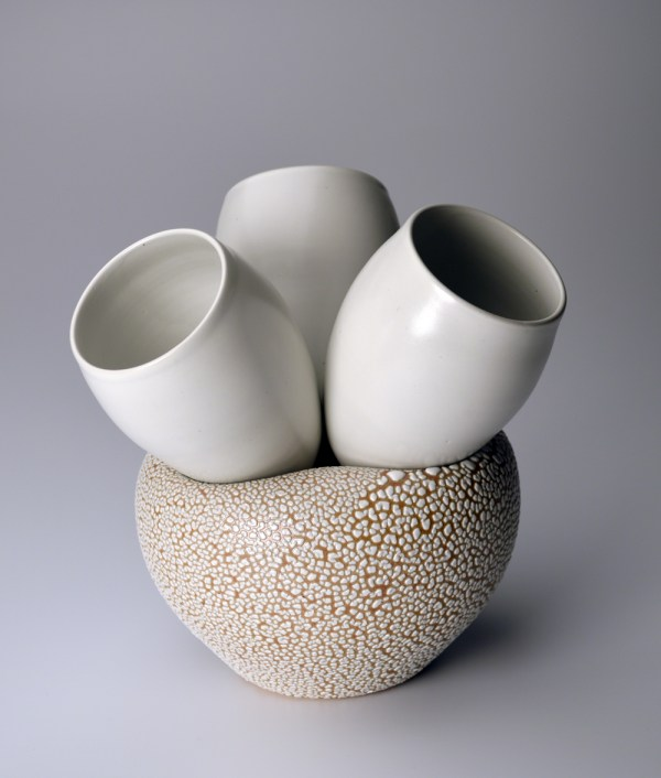 Thrown/inflated porcelain with satin white and reticulating glazes. Cone 10.