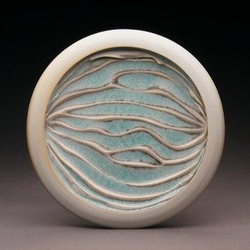 "Porcelain. 10.5"" in diameter"