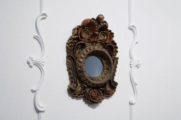 """{Frame}. Ceramic Frame, 29"""" x 24"""" x 7"""". Ceramic, glaze, plaster, paint, velvet backing. 2010."""