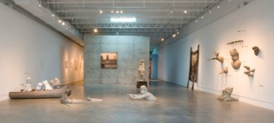 2011, Dimensions of space: 12'x22'x13', clay, luster, paint, wooden canoe, epoxy