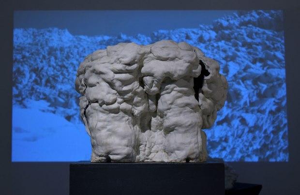 """cone 10 reduction hand-built porcelain, digital projection. 2016. Sculpture: 30""""H x 33""""W x 20"""" D. Projection 4'H x 9' W."""