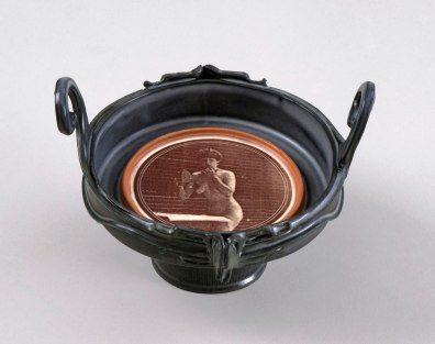 Earthenware, pigments, glazes. Slipcast, handbuilt, overglaze print, electric firing. 12.5 X 18 X 17 cm. 2013
