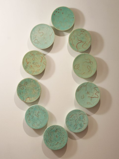 "wall sculpture, porcelain, glaze and lusters, 2008, 58"" H x 35"" x 2"""