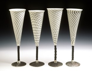 Champagne Flutes, hand-built with stretched slabs and extruded elements, porcelain, stenciled black slip, wrought iron stems, cone 10 reduction, 11 inches tall, 2001