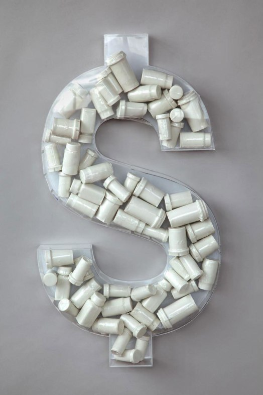"cast acrylic money symbol, porcelain cast pill bottles. 18""x 32""x 3"". 2010"