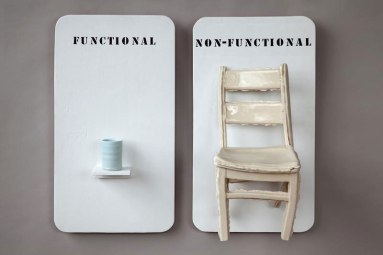 "wood panel, porcelain wheel thrown cup and porcelain press mold, cast chair. 24"" x 48"" x 12"" 2010"