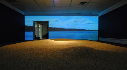 And the River Floweth On, Collaborative exhibition with Shawn Skabelund, shelled corn, mapped video projection, Greiner Art Gallery, Hanover College, Hanover, IN