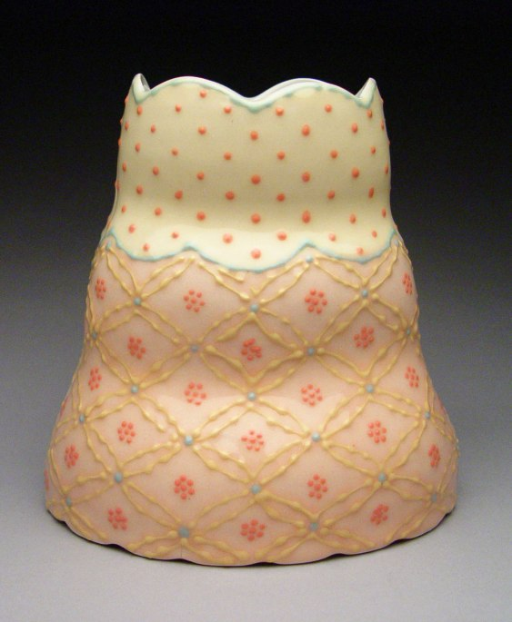 "Wheel-thrown and altered porcelain, colored slips and glaze, cone 6 - 6""x4""x11"""