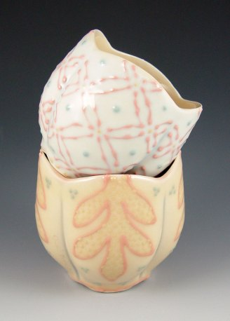 "Wheel-thrown and altered porcelain, colored slips and glaze, cone 6 - 3""x3""x4"" each"