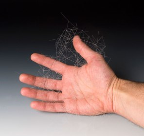 """Untitled (with hand for scale), nylon, 6"""" x 6"""" x 6"""""""