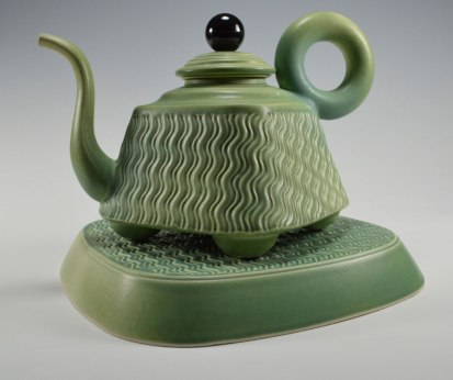 "slip cast porcelain, assembled parts, phenolic and steel parts, teapot 12""h x 12"" plinth (base, diagonal edge to edge)"