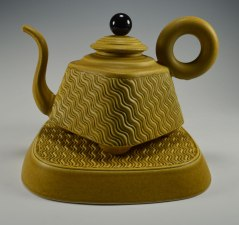 "slip cast porcelain, assembled parts, phenolic and steel parts, teapot 12"" h x 12"" plinth (base, diagonal edge to edge)"