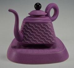 """slip cast porcelain, assembled parts, phenolic and steel parts, teapot 12""""h x12"""" plinth (diagonal edge to edge) 12"""""""