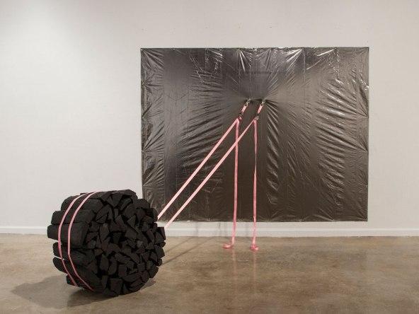 plastic sheet, graphite, hardware, logs, ratchet straps, 72 x 96 x 72 in., 2014