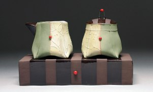 Handbuilt earthenware, terra sigillata, underglaze, and glaze, wire, 4x7x3