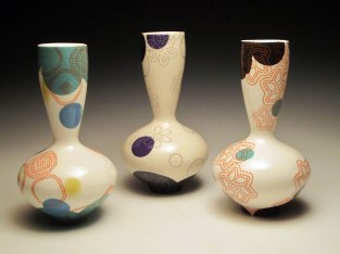 """Porcelain with decals, 9""""h x 5"""" x 5"""" each"""