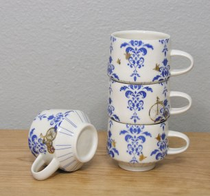 """Wheel-thrown porcelain, underglaze decals and custom gold decals, cone 7 & 018 oxidation, approximately 3x3x4"""" each"""