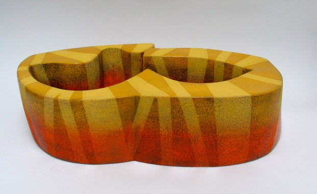 2014. Slab built, sanded, polished, under glazed (yellow, black whits and orange), clear glazed. h23 x w56 x d32cm