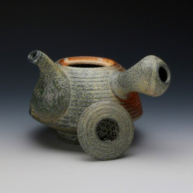 7 x 8 x 8, Wheel thrown coarse stoneware with striped texture and applied flashing slip and celadon glaze, soda fired to cone 10 in reduction.