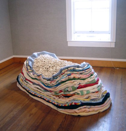"Porcelain, quilts, blankets, afghans, 2 1/2"" x 1 1/2"" x 1"" each, 6' x 3' x 2 1/2' total, 2008"