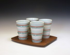 reduction fired porcelain, decals, walnut, 6 ¼ x 7 ½ x 9