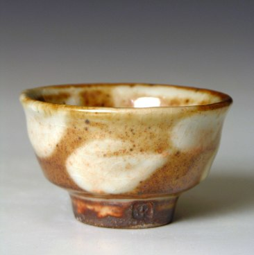 Shino glaze. White slip decoration. Wood fired. 3 inches across.