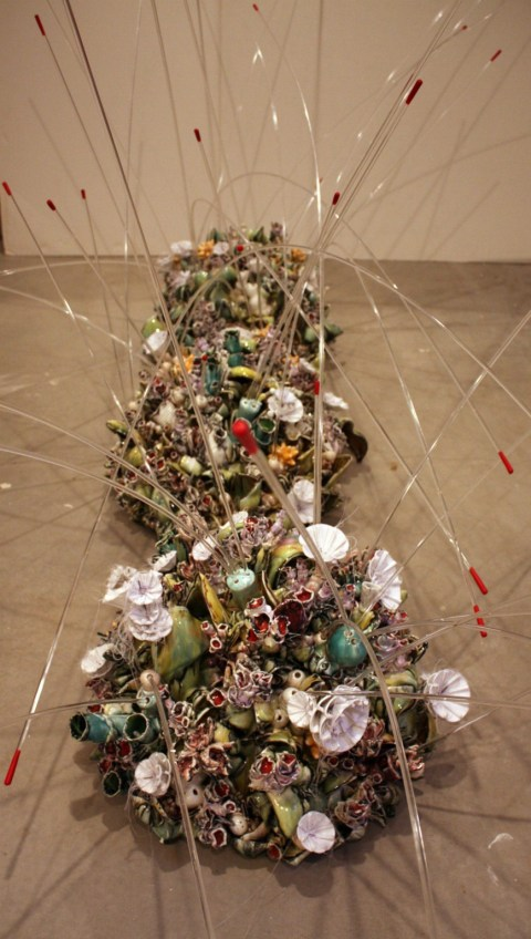 Germinating, 2011, floor installation, porcelain, acrylic, rubber, foam. 3 Ceramic dome