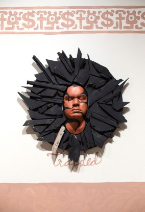 Trapped in the Promised Land; Ceramic, wood, oil and spray paint