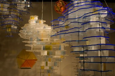 laser cut acrylic hanging and standing sculptures, wood, HO-scale figures, aluminum, video, sound, 2008