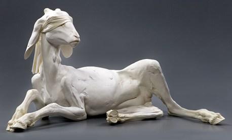 "Olympia, 27""h x 48""l x 35""d, 2006, stoneware, white porcelain slip, oil blush, cloth blindfold"