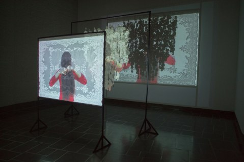 Video projection, ceramic, lace, steel, red thread, 10' x 9' x 9', 2015