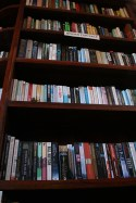 Rows and rows of books can be found on the looming shelf in Red Café.
