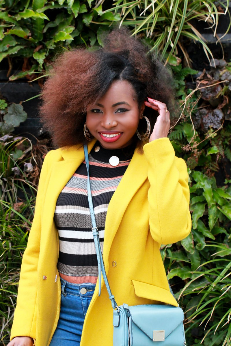 yellow coat afro hair blow dry a