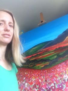 Artist Jacqueline Hammond with sold painting 'Field of Dreams'