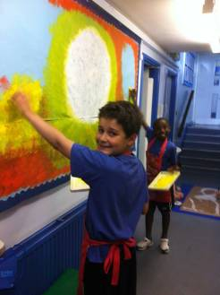 Painting the background of the African Savannah mural
