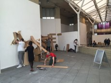 Students creating a cardboard sculpture