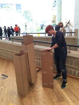 Sharon creating a cardboard sculpture