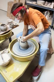 Potter Rinny Ryan demonstrates how to throw a pot on a potters wheel. Ryan is one of many artists that will be doing demonstrations at Arts Worldwide on Saturday, Nov. 21.