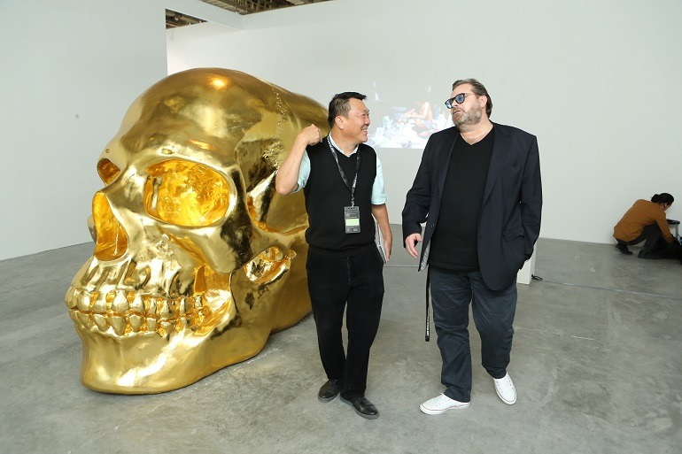 Image Celebrity Lorenzo Rudolf at Art Stage Singapore 2014 with another art lover.