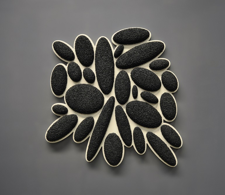 Image- Black and white textured sculpture- David Drumlin, Drops Series Pender in an unusual shape