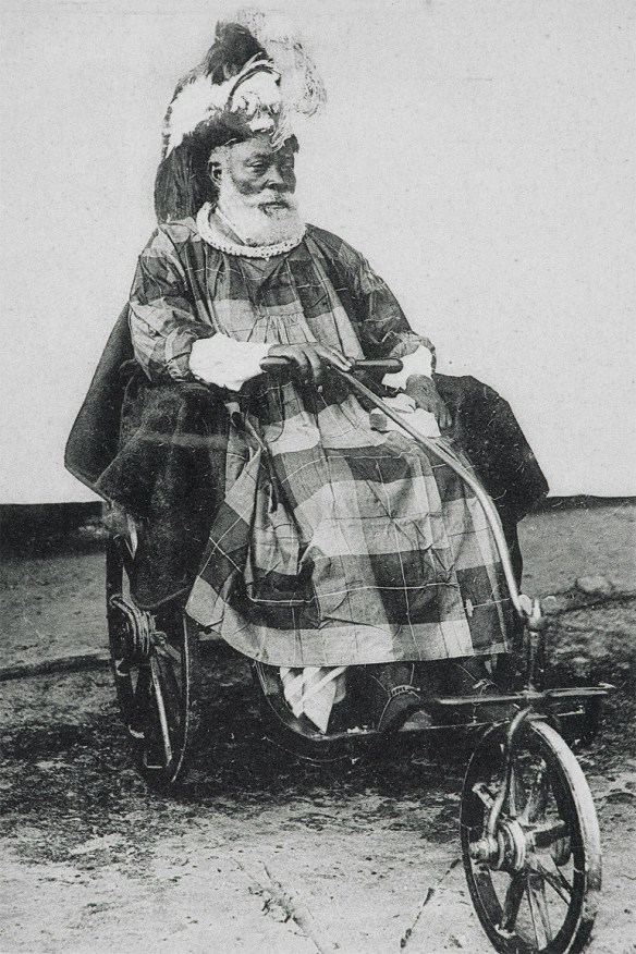 Image: Colonial Style Man, a photograph of a man on a tricycle colorfully dressed, shows the progress of photography in Nigeria